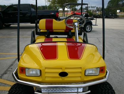 EZ-GO Lifted Yellow & Red 36 Volt Electric Golf Cart on